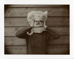 I'm fed up kids 1 (Erwan Bela) Tags: portrait mamiya sepia polaroid kid universal expired enfant 2009 suffocate 1600asa polythenebag prim touffer sacenplastique