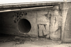 Drain sepia (Faithfull i) Tags: sepia graffiti pipe australia drain nsw albury axemaniac2012 axemaniacmay2012