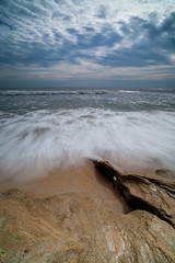 Motion (John Cothron) Tags: ocean longexposure cloud seascape beach water rock seashells 35mm canon landscape morninglight spring sand pattern florida cloudy scenic wave overcast atlanticocean saltwater ze stormyweather calcite sunshinestate coquina palmcoast flaglercounty windrain washingtonoaksgardensstatepark guanatolomatomatanzasnationalestuarineresearchreserve johncothron 5dmkii distagont2821 cothronphotography zeissdistagont21mm28ze 2jtrip20121 img08949120405 johncothron