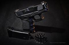_DSC6253WM (Ranie D) Tags: grid sb600 winchester gels 9mm nikon60mmf28micro strobist nikond90 blacktalon sb900 glock26