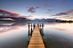 Jetty at Te Anau (Luke Tscharke) Tags: morning reflection clouds sunrise geotagged jetty teanau southland yachtclub fiordland luketscharke marakura geo:lat=4542711782726807 geo:lon=16771471633198553