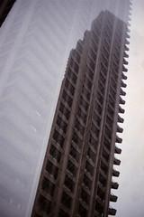 Cromwell Tower (fairminer) Tags: city uk greatbritain england london tower film architecture analog 35mm concrete nikon estate kodak britain doubleexposure modernism barbican 400 analogue portra mx brutalism modernist cityoflondon nikonfe2 fe2 kodakportra unitekingdom barbicanbonpowell