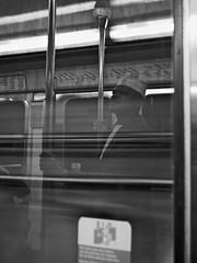Underground thoughts (Ben_Morio) Tags: man paris window hat speed underground subway alone metro map streetphotography reflet ratp 20mmlens blackwhote micro43 panasonicg3