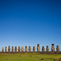 Monolithic Moai Statues At Ahu Tongariki, Easter Island, Chile (Eric Lafforgue) Tags: chile travel sky sculpture color colour history archaeology latinamerica southamerica nature statue rock stone mystery square outdoors photography polynesia ancient order exterior pacific guard bluesky nobody nopeople worldheritagesite zen majestic moai easterisland colorphoto rapanui inarow isladepascua hangaroa ahutongariki archeologicalsite southpacificocean traveldestinations largegroupofobjects placeofinterest oldruin internationallandmark ancientcivilisation 7860 polynesianculture malelikeness pukao humanrepresentation builtstructure polynesianisland southamericanculture moaistatues southeasternpacificocean polynesiantriangle chileanpolynesia