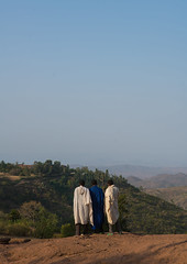 Ethiopian men walking along a hill, Amhara region, Lalibela, Ethiopia (Eric Lafforgue) Tags: africa people color tree men vertical walking religious outdoors clothing day african traditional faith hill religion scenic christian unescoworldheritagesite daytime christianity shawl spirituality copyspace rearview ethiopia hillside orthodox 2people twopeople adultsonly coptic developingcountry traditionalculture lalibela hornofafrica ethiopian eastafrica abyssinia traditionalclothing realpeople fulllenght traveldestination africanethnicity africanculture unrecognizableperson amhararegion semienwollozone ethio161444