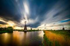 Windmills in Kinderdijk (radonracer) Tags: longexposure holland water netherlands windmill amsterdam clouds reflections kinderdijk langzeitbelichtung windmühle niederland