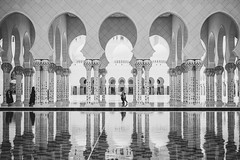 Grand View (Bartholomew K Poonsiri) Tags: travel urban blackandwhite building water pool monochrome architecture asia outdoor muslim islam uae middleeast wideangle mosque structure abudhabi column vault cloister archway sheikhzayedgrandmosque sonyepz1650mmf3556oss sonyilce6000