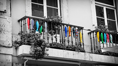 Balcony Art - Rua Augusta Lisbon, Portugal (Sebastian Bayer) Tags: street windows vacation building art texture portugal socks colorful pattern outdoor lisboa lisbon balcony balkon fenster kunst urlaub socken handrail ruaaugusta lissabon gebude bunt omd selectivecolor fische gelnder fisches strase drausen selektivefarben 124028 omdem5ii