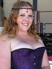 Celtic Fest Jewelry Vendor (J Wells S) Tags: ohio portrait smile beads costume cosplay dressup jewelry corset vendor vest curlyhair youngwoman waynesville bustier underbust candidportrait harveysburg prettyyoungwoman celticfestohio