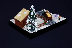 Nordheim Paddock (soccersnyderi) Tags: lego moc creation snow paddock cattle tree kids snowball road cobblestone hay feeder wagon cart roof wooden building fence