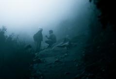 Mountainside Conspiracy (Hans Maso) Tags: nepal winter people mountain man cold men rock fog trekking canon rocks candid ef2470mmf28lusm trekker 2470mm 50d canoneos50d