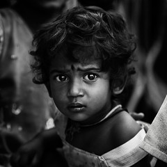 Curiosity is little more than another name for Hope (Rakesh JV) Tags: life street portrait bw india white black girl beautiful square photography hope lights kid eyes nikon child expression indian south 85mm curious nikkor f18 chennai powerful curiosity soulful tamil bnw jv nadu rakesh vadapalani catchlights cwc rjv d7000 chennaiweekendclickers