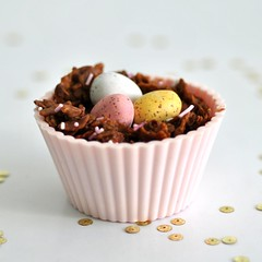 Molly's chocolate nest (toriejayne) Tags: pink easter gold nest chocolate pastel sprinkles eggs sequins cornflakes picnik minieggs