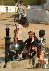 Village well (bokage) Tags: woman india water child well washing khajuraho madhyapradesh