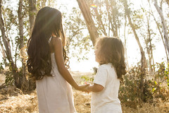 (Catherine McGrath) Tags: light boy summer sun sunlight white cute girl kids hair children dress longhair sunny siblings sheet curlyhair sunflare