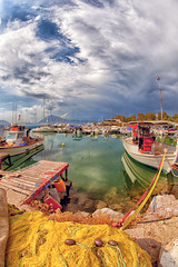 after all, it's a colourful life (dtsortanidis) Tags: sea 2 sky fish net water clouds port marina canon reflections lens boats dock rocks mark fisheye greece ii transparency l 5d usm ef 815 gettyimages dimitris patras patra dimitrios 815mm tsortanidis