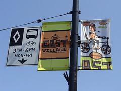 East Village (knightbefore_99) Tags: street nyc blue sky vancouver village bc cityhall banner east taxes hastings eastvan bureaucrat