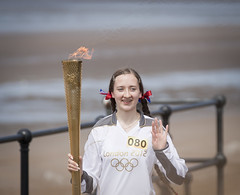 Jess Wade carries the Olympic flame at Crosby beach (Ianmoran1970) Tags: beach proud fence flame torch olympic relay crosby hff ianmoran jesswade ianmoran1970