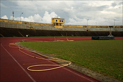 hue-6145-ps-w (pw-pix) Tags: blue red cloud white green sports grass yellow clouds wonderful concrete grey interesting track pattern afternoon cloudy stadium patterns soccer overcast running surface rubber hose line pitch weathered marking tangle hurdles dull decayed dilapidated tangled lateafternoon trackandfield steeplechase timecapsule olympicrings runningtrack sportsstadium olympicsymbol rubberised