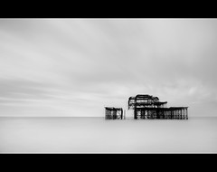 Pier. (Alex takes photos.) Tags: ocean sea sky white mist black west clouds pier high nikon key brighton long exposure welding 28mm ghost tripod ruin down filter burnt wreck tamron derelict processed burned ruined exp cs3 d610 loooong