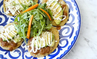 Tlacoyos ($6) | Refried beans, corn masa cake, Oaxaca cheese, fresh salsa, avocado, and arugula ontop