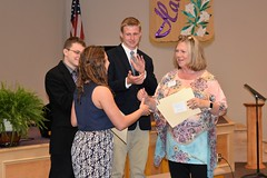Elizabeth Hartley presents Emily George $2,000 Community Spirit of Service Scholarship