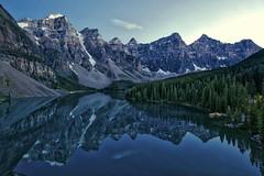 Moraine Lake calm glass (John Andersen (JPAndersen images)) Tags: forest reflections still twilight peaceful calm banff morainelake