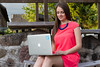 Work anywhere (Janis Baiza) Tags: pink blue woman girl smile smiling work hair necklace long dress legs laptop working anywhere