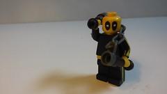 Sigfig (DanielBrickSon) Tags: yellow minifig brucelee deadpool