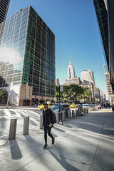 Walking Girl (Littlepois Photographie) Tags: street nyc usa ny newyork girl nikon unitedstates manhattan femme rue 6thavenue d4 etatsunis empirestatesbuilding colorefexpro lr4 littlepois nikon1635f4