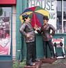 Is raining Laurel! (Gabo Barreto) Tags: uk england colour slr 120 6x6 film rain umbrella mediumformat funny yorkshire leeds agfa raining figures kiev88 laurelhardy optima c41 sovietcamera elgordoyelflaco secondhadfurniture