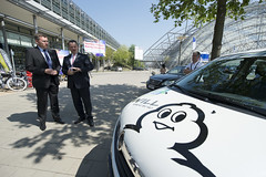 Jan Muecke standing by a Michelin electric car