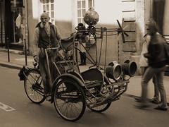 Drôle d'engin (woodstockbrother) Tags: portrait paris france sepia 35mm vintage spring nikon europe tricycle retro moustaches f18 velo ancien engin d3100