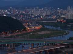 Daejeon-Night-South Korea (mikemellinger) Tags: bridge mountains water beauty night buildings river dark landscape lights evening scenery stream apartments dusk korea hills southkorea crowded daejeon northasia