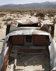 Car Crushed and Rotting (Curtis Gregory Perry) Tags: auto old abandoned car garbage automobile desert nevada dump mobil dyer rusted motor coupe crushed automvil xe automobil     samochd  kotse  otomobil   hi   bifrei  automobili   gluaisten