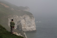 On the Edge (Neil Nicklin Photography) Tags: sea summer cliff white mist man hot misty fog canon lens t eos coast warm candid yorkshire north foggy thoughtful cliffs 300mm landing caves edge thinking cave tamron smuggler bloke smugglers ocen 70mm flamborough thouht 1100d