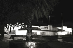 Drouin Primary School at night (phunnyfotos) Tags: school bw building monochrome architecture modern night 1936 lights blackwhite nikon australia monotone victoria palm moderne palmtree vic streamlined primaryschool streamline gippsland drouin stateschool percyever