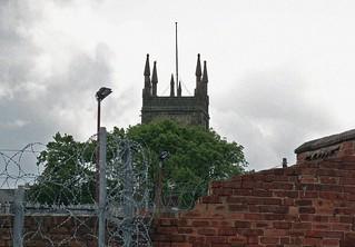 Ilkeston - Snapshot -  Razorwire, Wall and the Parish Church Tower  . June 14th 2012