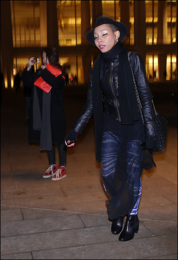 w black leather coat black chimera skirt over print leggings black chanel bag black hat ol