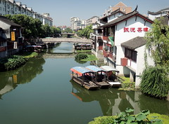 Qibao old water town of Shanghai (Germn Vogel) Tags: china travel bridge reflection tourism river boat canal asia village shanghai riverside traditional oldtown watertown waterreflection eastasia oldquarter traditionalhouse qibao recreationalboat