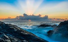 Cloudy Sunrise (Dhiren Bhundia) Tags: morning sky orange cloud sun beach nature water beautiful clouds sunrise rocks waves rays ora