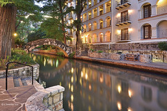 San Antonio Nights (A. Shamandour) Tags: city sunset storm motion color building art water sanantonio clouds speed sunrise reflections river boats photography lights photo cityscape texas slow walk nights scape towards riverwalk shutterspeed waterscape
