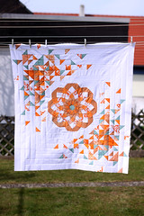 New quilt top (almost) finished (1) (ShapeMoth) Tags: dahlia orange white tangerine modern aqua quilt teal patchwork hst halfsquaretriangles shapemoth