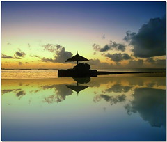 Evening calm (Nespyxel) Tags: travel sunset sea seascape male water silhouette reflections evening tramonto mare piscina swimmingpool maldives riflessi viaggio sera atoll maldive reflexes beachumbrella ombrellone olhuveli atollo nespyxel stefanoscarselli