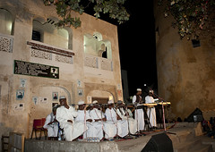 Men Reciting Poetry At Night Time During Maulidi Festival, Lamu, Kenya (Eric Lafforgue) Tags: africa color architecture island photography sitting kenya culture unescoworldheritagesite unesco worldheritagesite afrika tradition lamu swahili afrique eastafrica villagesquare mawlid qunia lamuisland lafforgue traveldestination africanethnicity kanzu kenyaafrica muslimislam  qunia    kea exterioroutdoors   tradingroute blackethnicity a maulidifestivalbarazacultureculturalgathering 123381 kofiahat