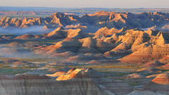 Badlands Canyon Sunrise (wellscenephotography (ON)) Tags: park light summer vacation usa grass fog sunrise landscape warm shadows south gap canyon formation national badlands dakota banded 2011 gap2012 gapreview gapselected gapapril gapreview002