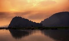 After the Rain (DPGold Photos) Tags: travel sunset sun mountains water landscape boats asia southeastasia vietnam portfolio ninhbinh northvietnam
