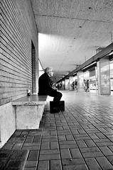 pazienza (Il cantore) Tags: bw man rome roma station bench blackwhite waiting profile perspective platform bn uomo sit priest ostia bianconero paved attesa prospettiva panchina marciapiede profilo prete seduto lastricato gentediromaromamor ontheroadromamor periferiaromamor altraromaromamor dintorniromaniromamor 15challengeswinner vitadistradaromamor ostiaromamor stazionelido stazjone