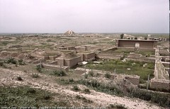 Nimrud, Iraq.  Temple of Nabu.  Ziggurat in the distance.  View from the south.  April 1990. (StevanB) Tags: archaeology ancient iraq assyria ashurnasirpal stevanb