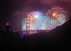 Multi-colored Burst of Light  [Explored ] (JohnCramerPhotography) Tags: sanfrancisco california silhouette fireworks illumination goldengatebridge bakerbeach animalia mammalia rodentia foxsquirrel 75thanniversary sciuridae